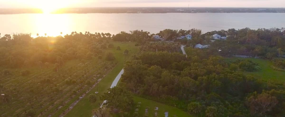 Waterfront 50 Acre Family Compound perfect for film and photo shoots! Unlimited vistas and space for endless inspiring options! in merritt island Hero Image in undefined, merritt island, FL