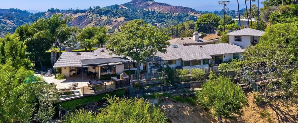 Spectacular Newly Renovated 4 Bed/5 Bath of this hilltop compound with explosive canyon & city views in Los Angeles Hero Image in Central LA, Los Angeles, CA