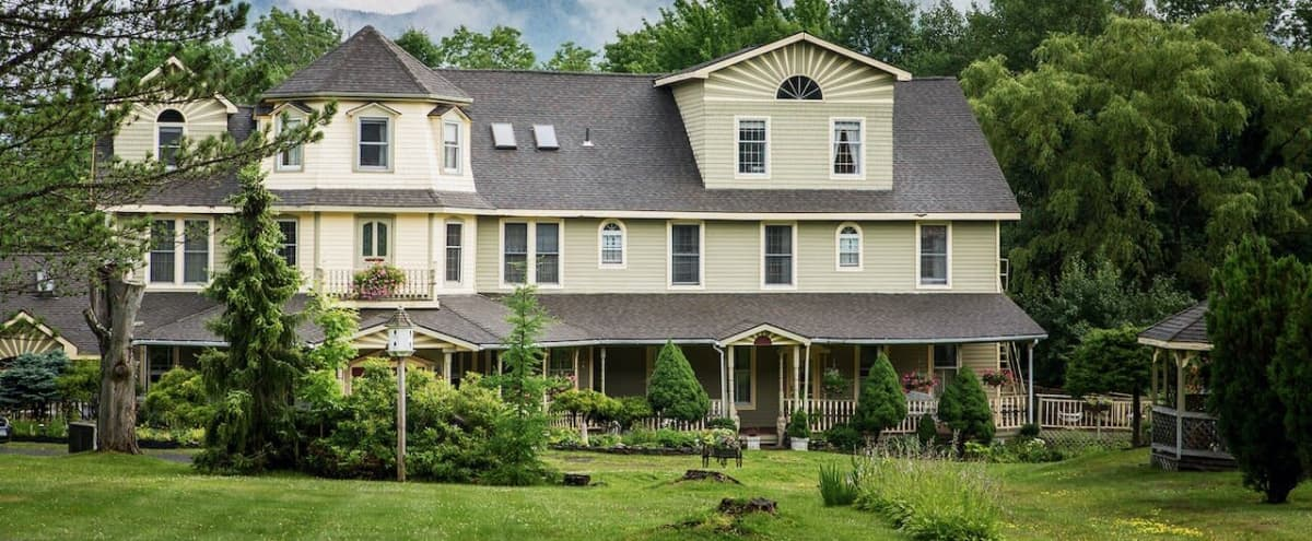"""1890s Victorian Inn with bar, event space, pool, accommodations for 40+, wood-paneled library/private dining room, commercial kitchen, and swimming pool plus 7 acres of woodlands and """"haunted"""" house in Hunter Hero Image in undefined, Hunter, NY"""