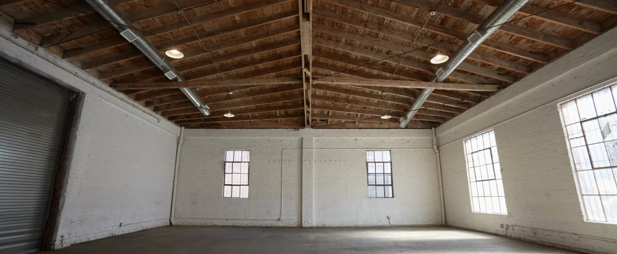 Downtown Brick Warehouse with Bowed Wooden Beams in Los Angeles Hero Image in Historic South Central, Los Angeles, CA