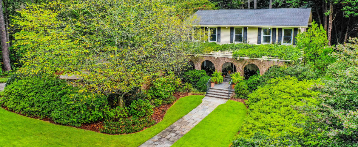 Private gardens with gazebo, tennis lawn, and more in Tucker Hero Image in undefined, Tucker, GA