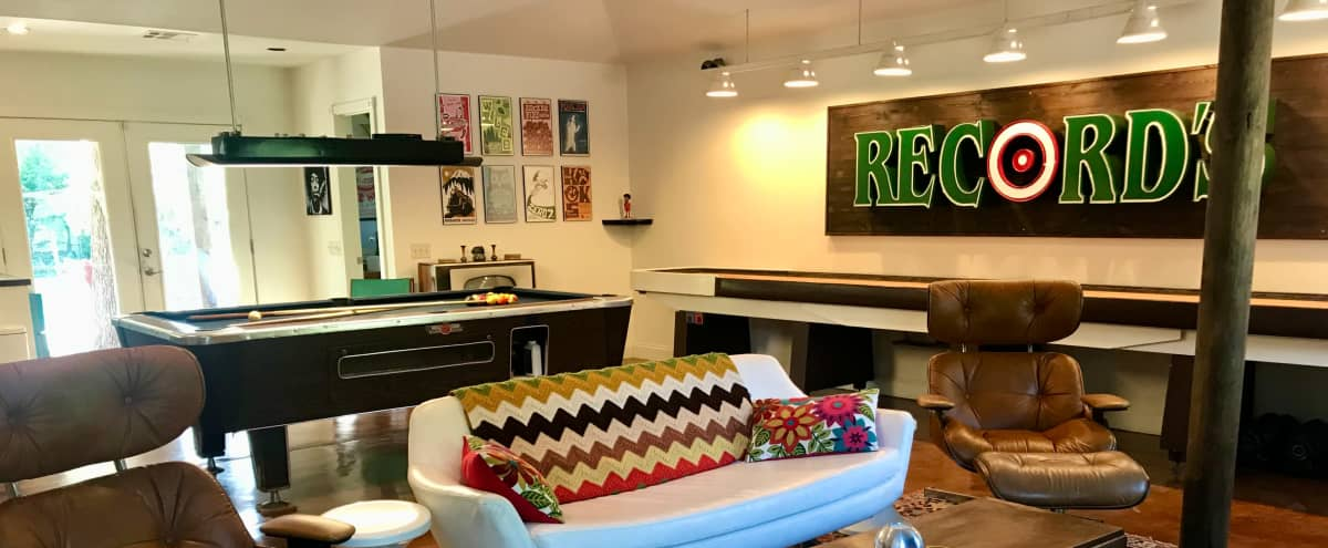 Retro Gameroom with Mid Century Style Swimming Pool and Backyard Vintage Trailer in a Country Setting in Austin Hero Image in West Oak Hill, Austin, TX
