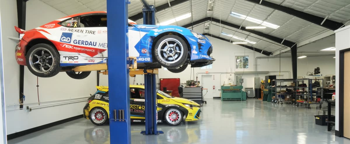 Clean Automotive Shop Technical Space with Lift. in Carson Hero Image in undefined, Carson, CA