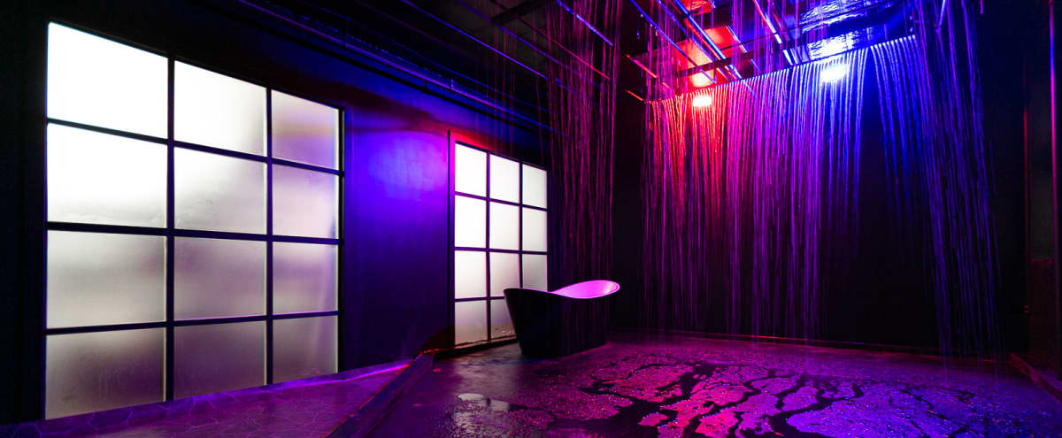 Unique Blackout Rain Room studio with heated water, RGB Lights, Black Bathtub, 4 Rain patterns, and black brick walls - Astoria 7 in Astoria Hero Image in Astoria, Astoria, NY