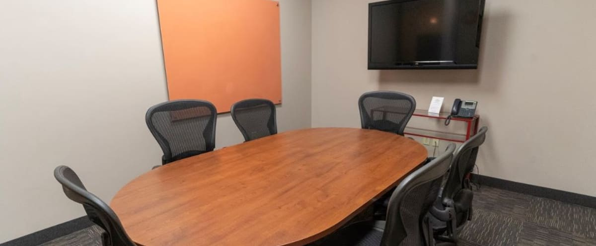 6 Person Conference Room w/ TV & Whiteboard in St Louis Park Hero Image in Blackstone, St Louis Park, MN