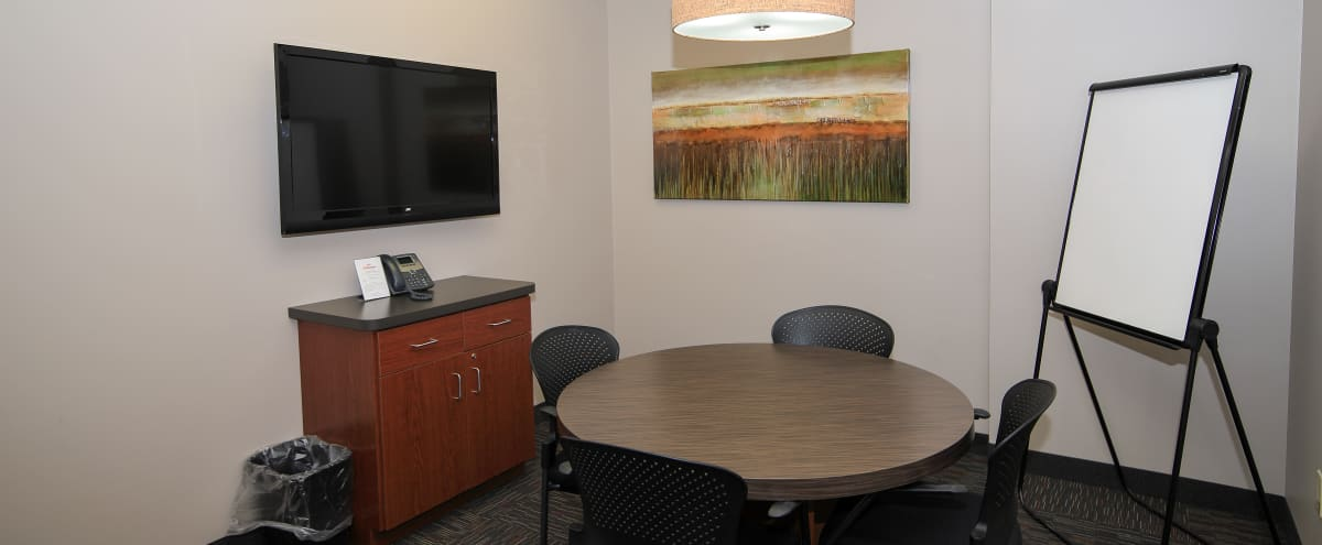 Cozy Collaboration Room - TV - Flip Chart - Conference Phone in St Louis Park Hero Image in Blackstone, St Louis Park, MN
