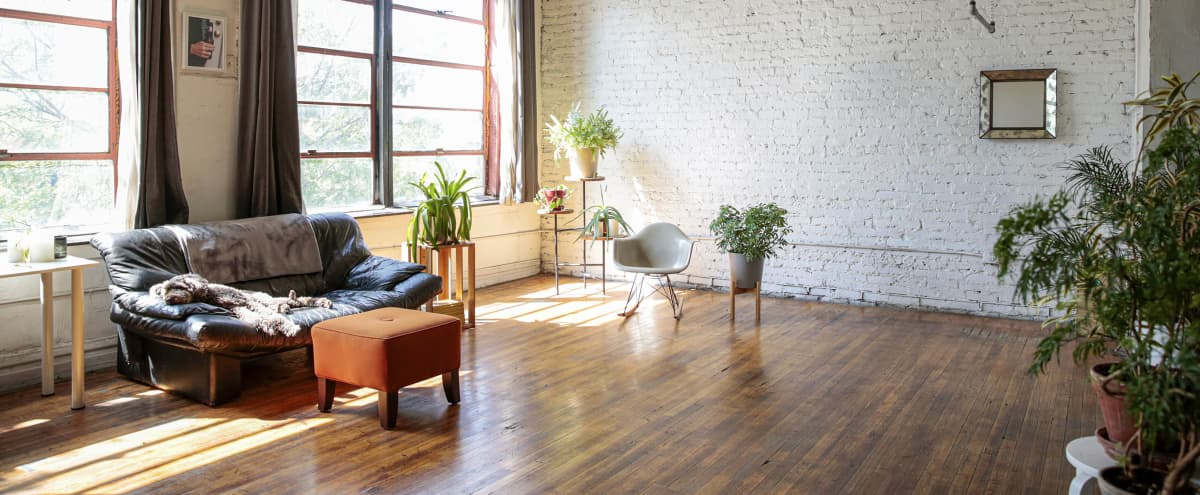 Airy, light-filled artist loft & studio with varied spaces for a location shoot with additional empty studio ideal for staging or alt setups. in Chicago Hero Image in West Town, Chicago, IL
