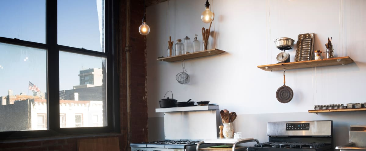 Industrial Brooklyn kitchen studio loft with amazing light, old beams, high ceilings in Brooklyn Hero Image in Sunset Park, Brooklyn, NY