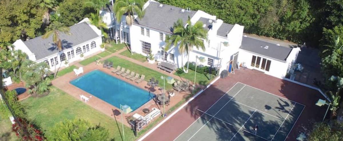 Amazing Backyard with Pool & Tennis Court in Los Angeles Hero Image in Bel Air, Los Angeles, CA