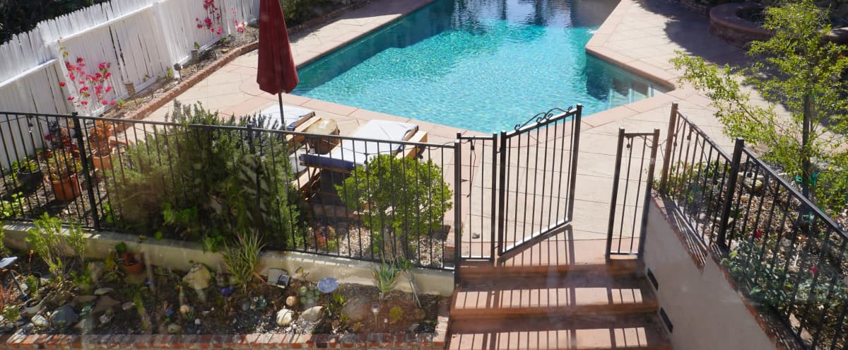 Tarzana Oasis w/ Pool, Basketball, Tennis court, Separate spa with a flowing rock waterfall in Tarzana Hero Image in Tarzana, Tarzana, CA