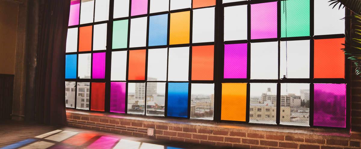 Unique DTLA Vintage Loft Studio w/ Colorful Windows, Stage, Props, Natural Lighting, Easy Parking in Los Angeles Hero Image in Central LA, Los Angeles, CA