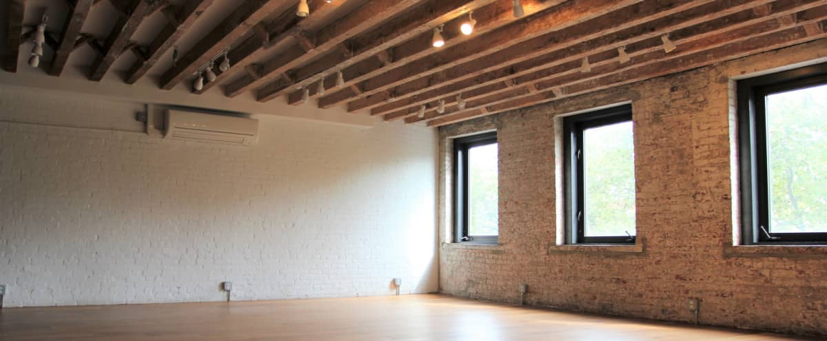 Conveniently-located Studio with Exposed Brick & Park Views in LES in New York Hero Image in Chinatown, New York, NY