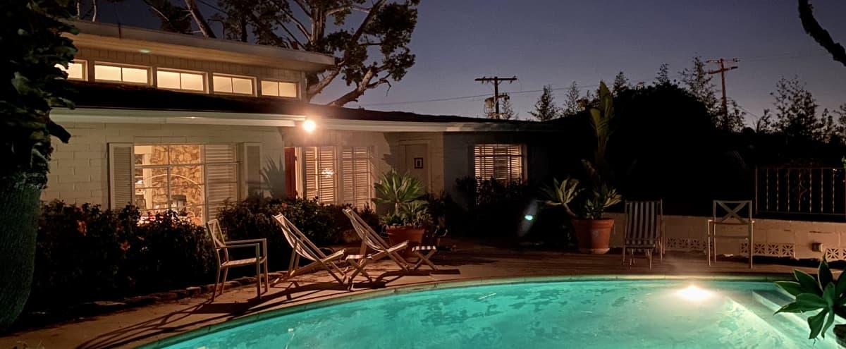 Mid-Century Time Capsule w/Stunning Views & Pool in Los Angeles Hero Image in Hollywood Hills, Los Angeles, CA