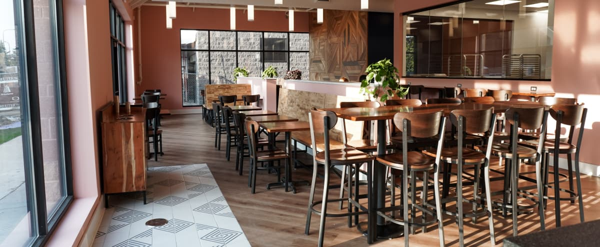 Restaurant Dining Room with Pastel Pink Walls & Custom Wood in Saint Paul Hero Image in Macalester - Groveland, Saint Paul, MN