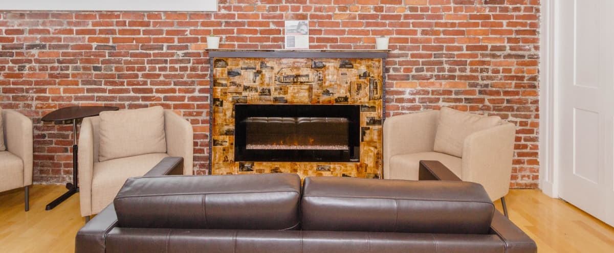 Lounge with Fireplace and Exposed Brick in Winthrop Hero Image in undefined, Winthrop, MA
