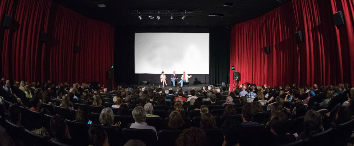 Large Presentation Space and 2 Theaters with free parking in Austin Hero Image in St. John/Coronado Hills, Austin, TX