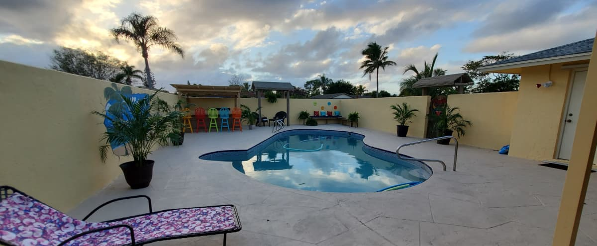 Private luxury pool home with entertainment space. in Royal Palm Beach Hero Image in undefined, Royal Palm Beach, FL