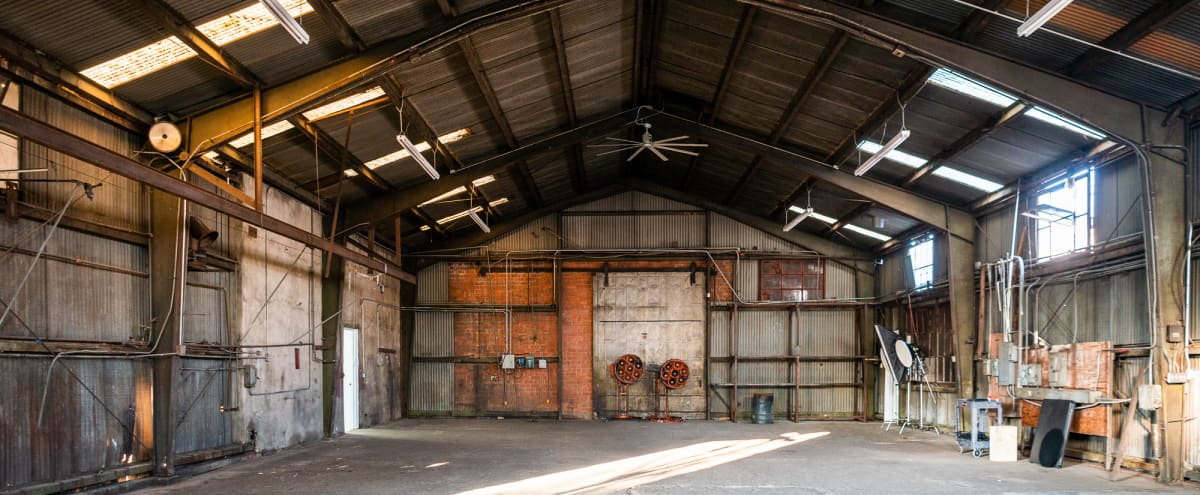 Olympic 5 - Huge metal hangar with car access and dedicated production room, restrooms and MUA tables for rent for photo and filming productions in Los Angeles Hero Image in Boyle Heights, Los Angeles, CA