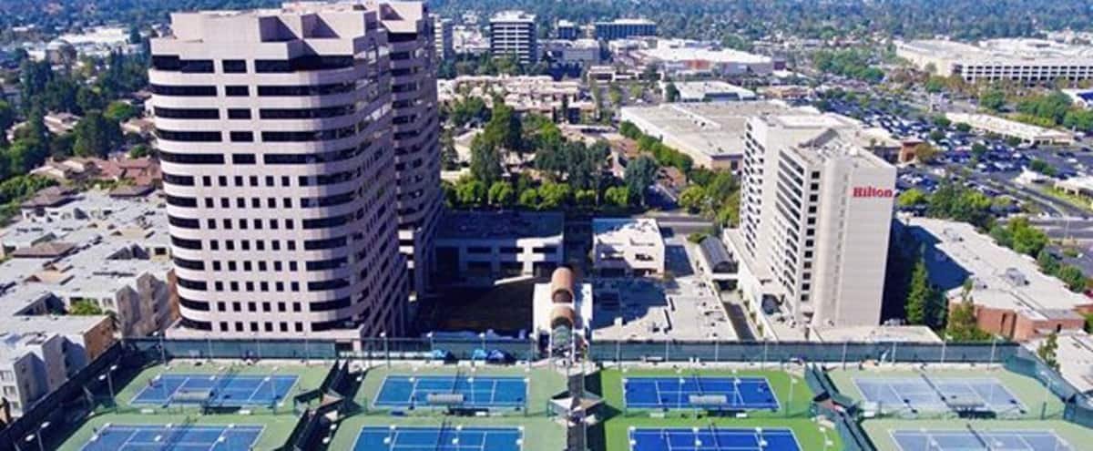 San Fernando Valley roof top tennis courts with INCREDIBLE views of the surrounding LA Valley. Private tennis club with great parking, easy access, and great privacy for film and photo shoots. in Woodland Hills Hero Image in Woodland Hills, Woodland Hills, CA