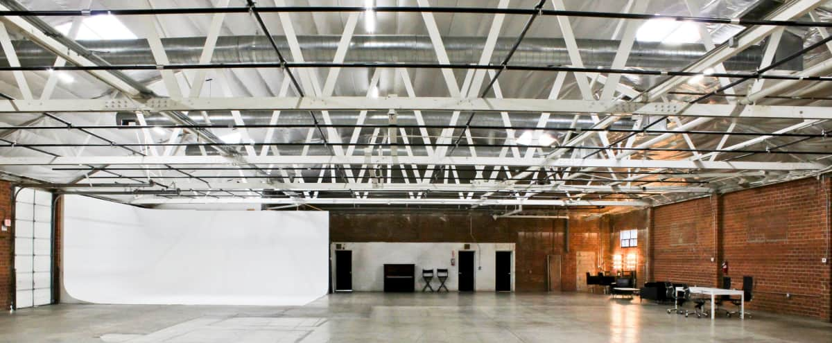 Polished Warehouse Studio with Exposed Brick & Large Cyclorama Wall in Los Angeles Hero Image in South Los Angeles, Los Angeles, CA