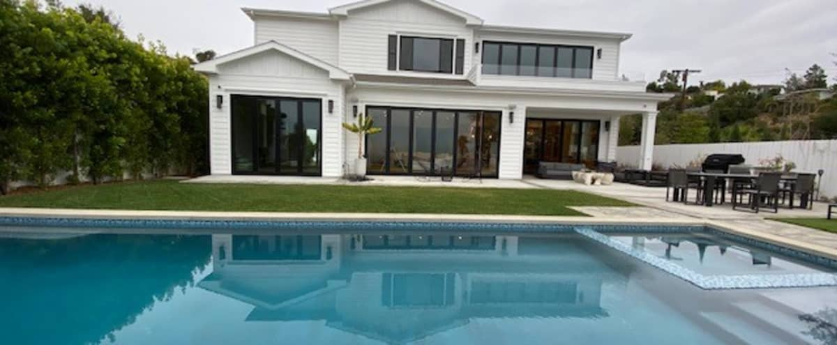 Modern cape cod in the hills with city and ocean views in Los Angeles Hero Image in Brentwood, Los Angeles, CA