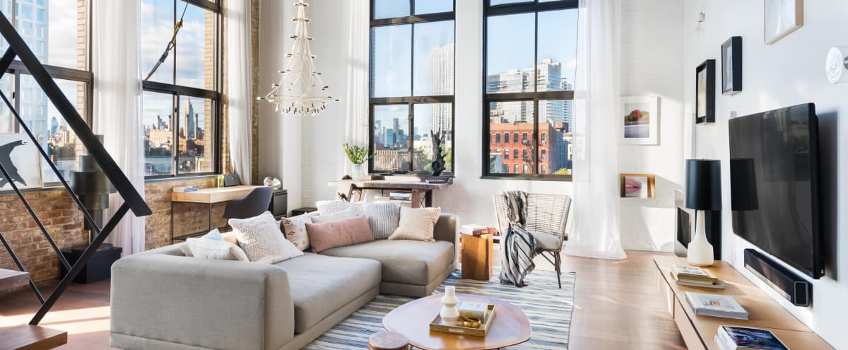 Architect's Masterpiece Modern Loft w/double height ceiling fab. River & city views in Brooklyn Hero Image in Williamsburg, Brooklyn, NY