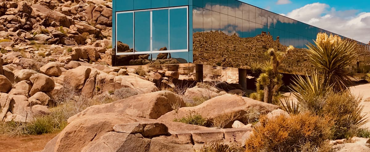 Invisible House mirrored nestled in 90 acres of rocks like another planet sci fi beyond in Joshua Tree Hero Image in undefined, Joshua Tree, CA