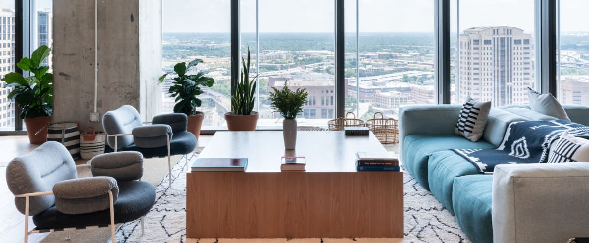 Amazing lounge space featuring floor-to-ceiling windows, a pool table, and stunning views of Downtown Houston! in Houston Hero Image in Downtown Houston, Houston, TX