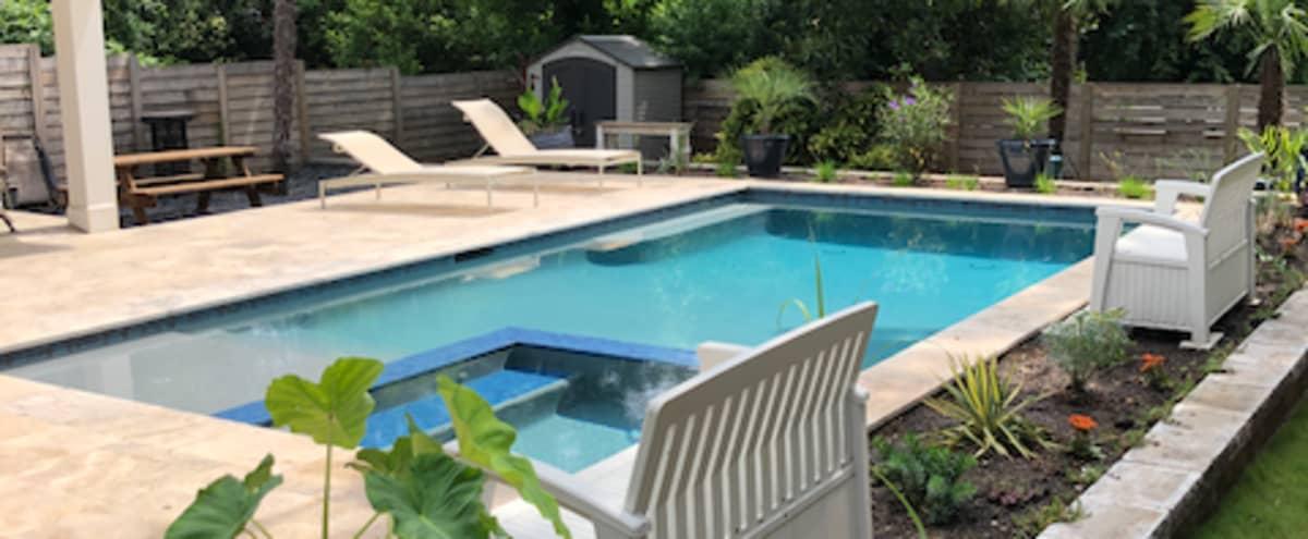 Tropical pool/backyard in modern downtown Atlanta bungalow in Atlanta Hero Image in Ormewood Park, Atlanta, GA