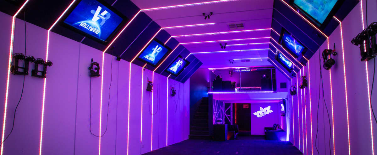 Modern event space with speakers on Hollywood blvd. + lasers, photobooth, digital billboard with your custom welcome message in Los Angeles Hero Image in Central LA, Los Angeles, CA