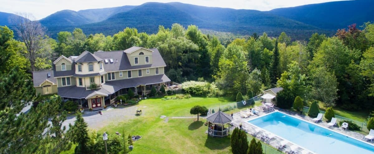 Distinctive Victorian inn with sun-drenched reception room, bar, wood-paneled private dining room, pool. (Overnight accommodations for 40.) in Hunter Hero Image in undefined, Hunter, NY