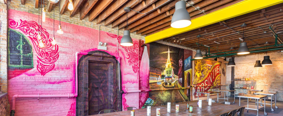 Spacious Industrial Room with Murals and Commercial Kitchen in Logan Square in Chicago Hero Image in Belmont Cragin, Chicago, IL