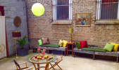Open air patio space behind a handsome vintage men's haberdashery in Humboldt Park, Chicago in Humboldt Park, Chicago, IL | Peerspace